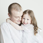 Portrait of beautiful smiling family: father and daughter — Photo