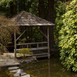 Hut on the water in garden — Stock Photo