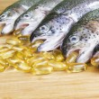 Fish Oil Time - Stock Photo