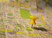 Yellow pushpin on a map — Stock Photo