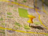 Yellow pushpin on a map — Stock Photo