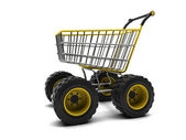 Shopping basket with big wheels — Zdjęcie stockowe