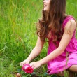 Girl grow flower — Stock Photo