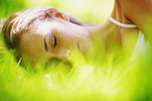 Woman sleep on grass — Stock Photo
