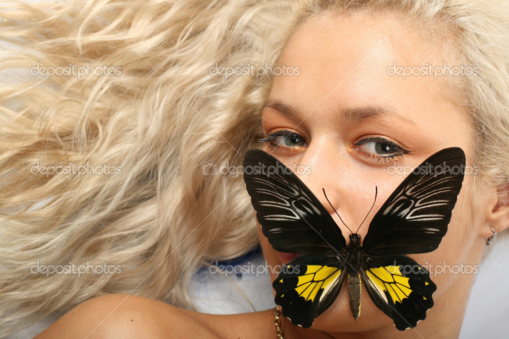 Shut up girl and colorful butterfly on her lips — Stock Photo #10242264