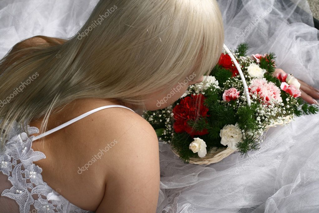 Bride look at you very beautiful in white flowers basket — Stock Photo #10376725