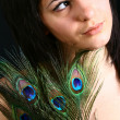 Peacock girl portret — Stock Photo
