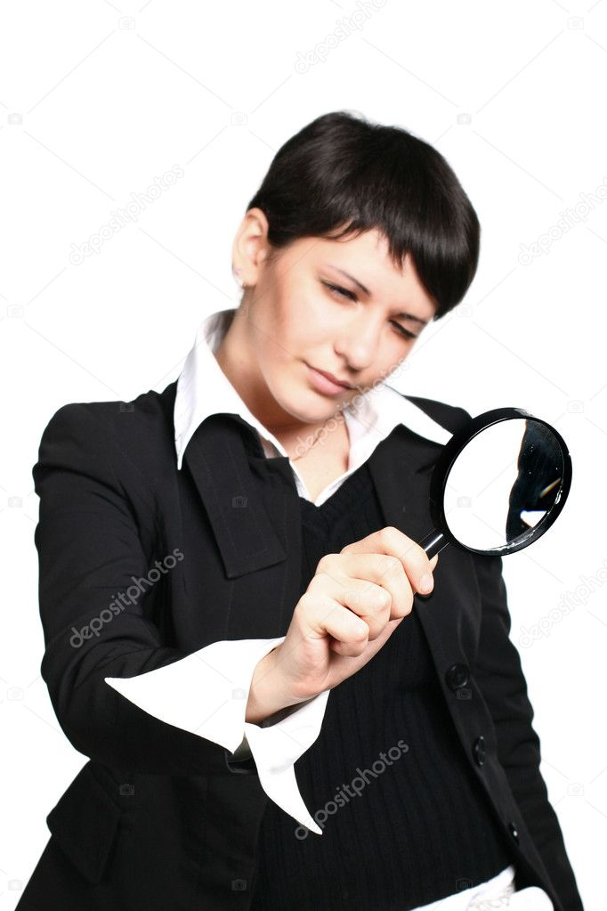 The business girl searches for something through a magnifier — Stock Photo #10459798