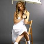 Girl with a umbrella — Stock Photo #10599452