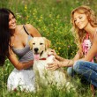 Girlfriends and dog — Stock Photo #10635260