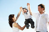 Happy family in sky — Stock Photo