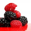Berry mixed pile in syrup - Stock Photo