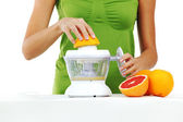 Woman squeezes juice — Foto Stock