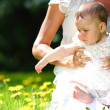 Mother and daughter on the green grass — Stock Photo