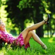 Girl lying under a tree — Stock Photo