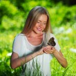 Woman playing with a butterfly — Stock Photo #8515994