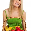 Woman holds a basket of fruit — Stock Photo #8516069
