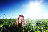 Woman on green grass — Stock Photo