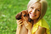 Woman dachshund in her arms — Stock Photo