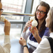Stock Photo: Women licking ice cream