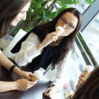 Happy women licking ice cream — ストック写真