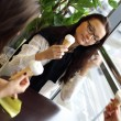Happy women licking ice cream — Stok fotoğraf