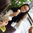 Happy women licking ice cream — Foto de Stock