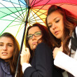 Girlfriends under umbrella — Stock Photo #8547852