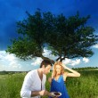 Stock Photo: Lovers on picnic