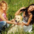 Girlfriends and dog — Stock Photo #8566544