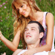 Lovers on grass field — Stock Photo