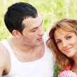 Lovers on grass field — Stock Photo #8567171