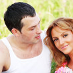 Lovers on grass field — Stock Photo