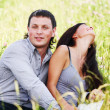 Lovers on grass field — Stock Photo #8567218
