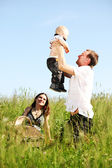 Family in grass — Photo