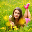 Woman blow on dandelion — Stock Photo #8691927