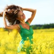 Stock Photo: Woman on oilseed field