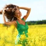 Woman on oilseed field — Stock Photo