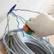 Worker puts the wires - Stockfoto