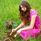 Girl grow flower — Stock Photo