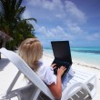 Tropical business woman with laptop — Stock Photo #8707863