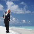 Happy business woman on the ocean coast — Stock Photo #8707883