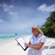 Business woman with blank paper on the ocean coast — Stock Photo #8707889