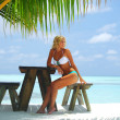 Stock Photo: Woman in a tropical cafe