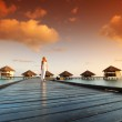 Woman in a dress on maldivian sunset — Stock Photo #8708019