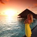 Woman in a dress on maldivian sunset — Stock Photo #8708095