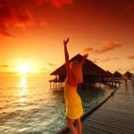Woman in a dress on maldivian sunset — Stock Photo #8708097