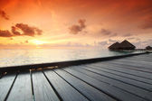 Maldivian houses on sunrise — Stock Photo
