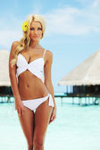 Woman on tropical beach — Stock Photo