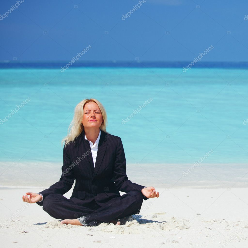 Yoga business woman in lotus pose on the beach — Stock Photo #8707892